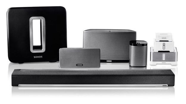 The Sonos family of powered speakers and integration products. At the rear left is their subwoofer. The Play:3, Play:5, and Play:1 are grouped in the middle rear. At the front is Playbar for home theater. At the rear right are the integration products.